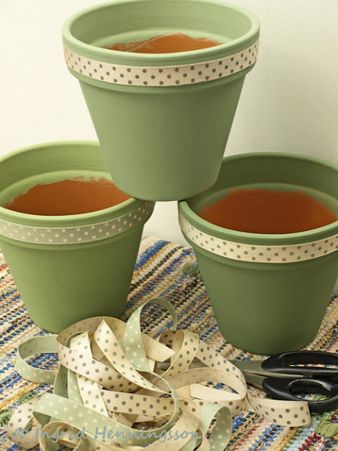Painted terracotta pots with ribbons