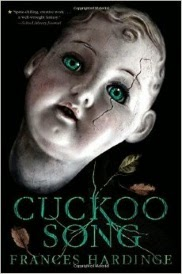 Cover of Cuckoo Song, featuring a pasty white china doll's head with molded hair and a crack running across one green glass eye.