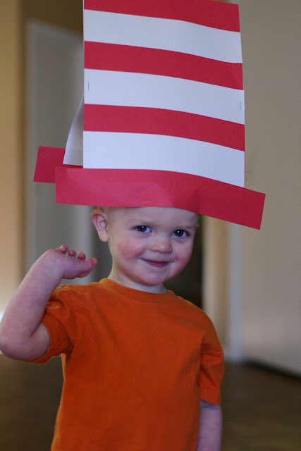 Child modeling a homemade paper hat