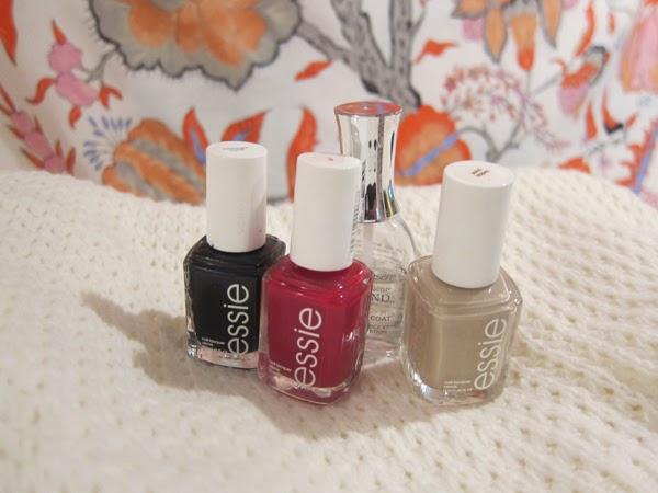 three colors of nail polish and a clear coat