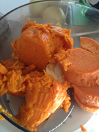 Sweet potato flesh cut up in food processor bowl