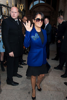 Salma Hayek waves to cameras