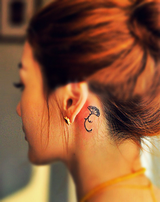 little folding fan tattoo behind the ear