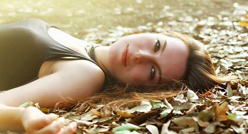 Cute Female Lying on Ground Image