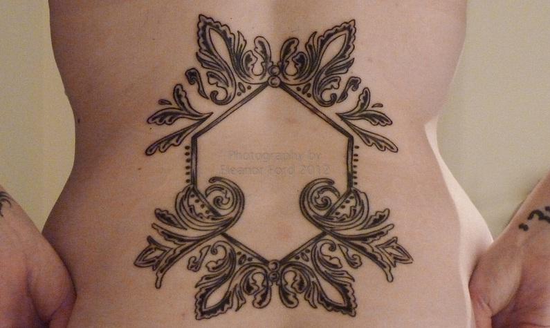 Twilight saga inspired tattoos bella 39 s wedding dress for Tattoo lace back wedding dress