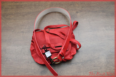 red purse with ribbon