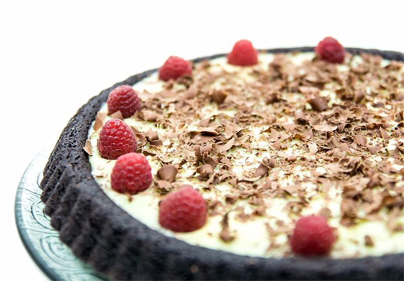 Triple chocolate cake raspberry really close up