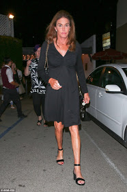 Caitlyn Jenner steps out in black sheer dress and the look is just not straight.