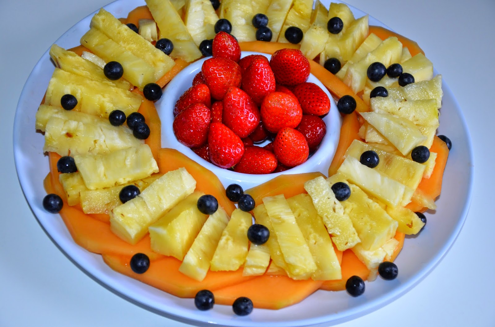 cantaloupe, pineapple, strawberries and blueberries,