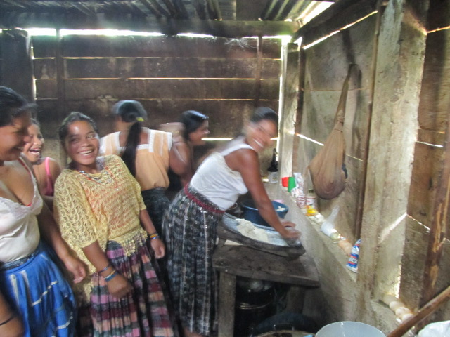 sisters making tortillas