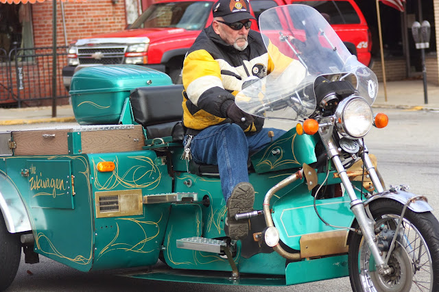 Veteran on green motorcycle