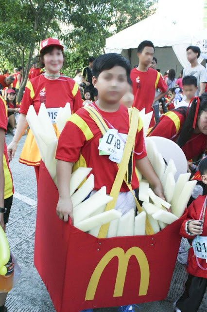 Boy wearing a McDonald's French Fries costume
