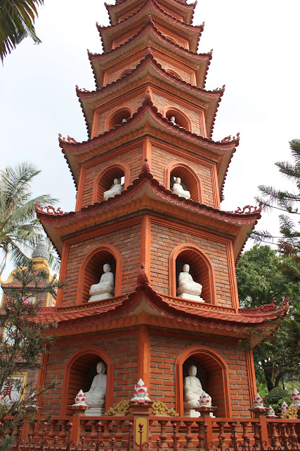 A statue of Amitabha made of gemstone can be seen on every level of stupa with its vaulted window on the pagoda at Tran Quoc Pagoda in Hanoi, Vietnam