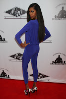 Jessica White wearing purple leggings and top on the red carpet
