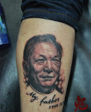 father's portrait as a tattoo on the arm
