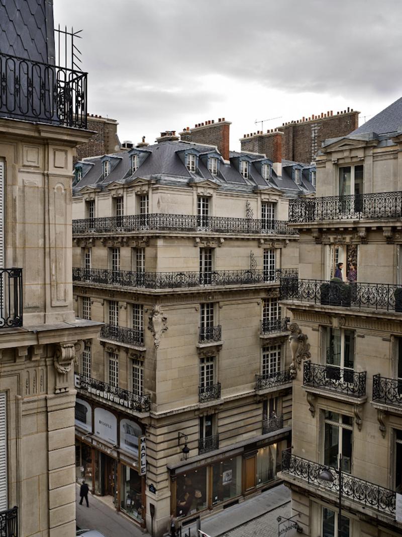Voyeuristic Photos Capture Intimate Scenes Through Apartment Windows in Paris by American photographer Gail Albert Halaban