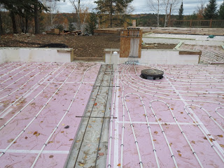 hot water in floor heating tubes, custom lake home construction huisman