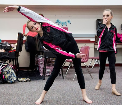 Dance Moms - Chloe Lukasiak Stretches while Teammate Maddie Ziegler Watches