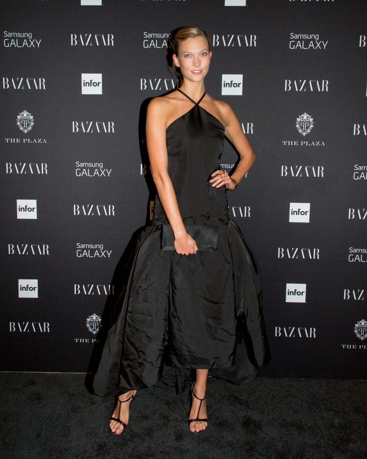 Karlie kloss was every bit the glamorous model she is for the elite party the victoria s secret model arrived looking elegant in a halter black dress with