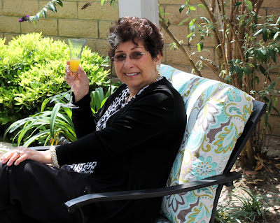 woman sitting in an outdoor chair with new fabric hot glued on