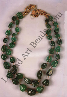 KANTHA (necklace) Private collection A double string of polished emerald beads assembled over a period of time, totally weighing approximately 1000 carats.