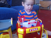 Big Boy playing with the Tonka Town Toys Fire Station