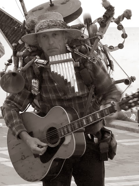 Street musician in Key West, FL.  Photo via WikiMedia