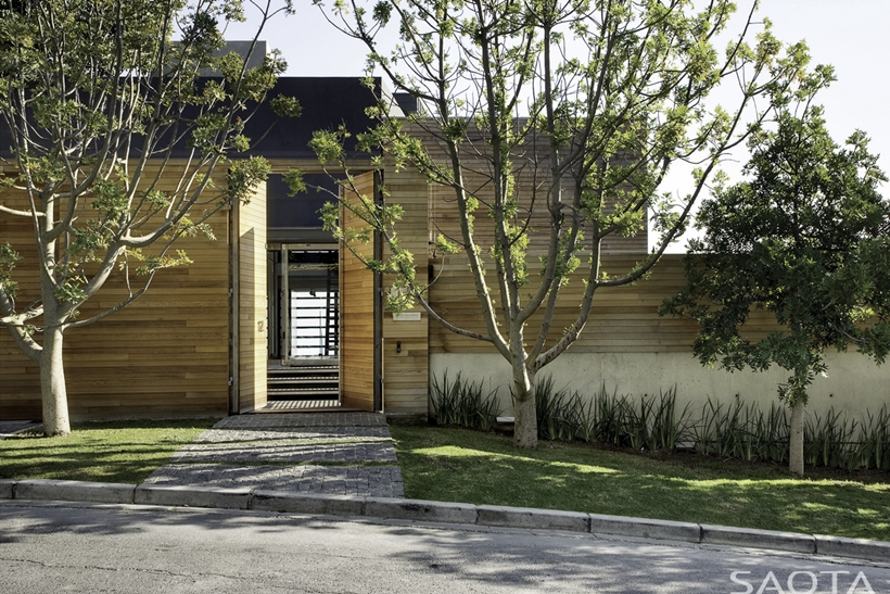 Contemporary entrance and wooden facade