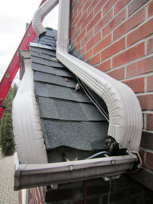 clogged downspout downpipe leafguard eavestrough installation