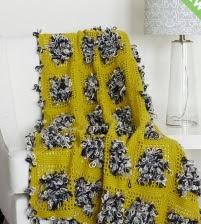 http://www.yarnspirations.com/pattern/crochet/throw-loop