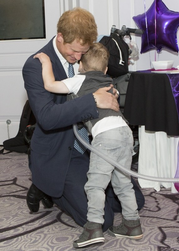 Prince Harry may be fourth in line for the throne, but he became king in our hearts after he hugged a young boy at an awards ceremony honouring sick children and their helpers.