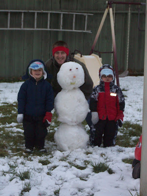 The boys and their first snowman of the season.
