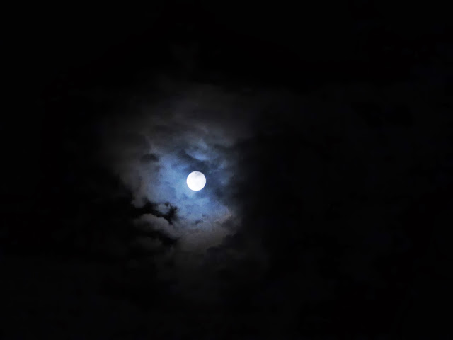 Moon in sky cloudy