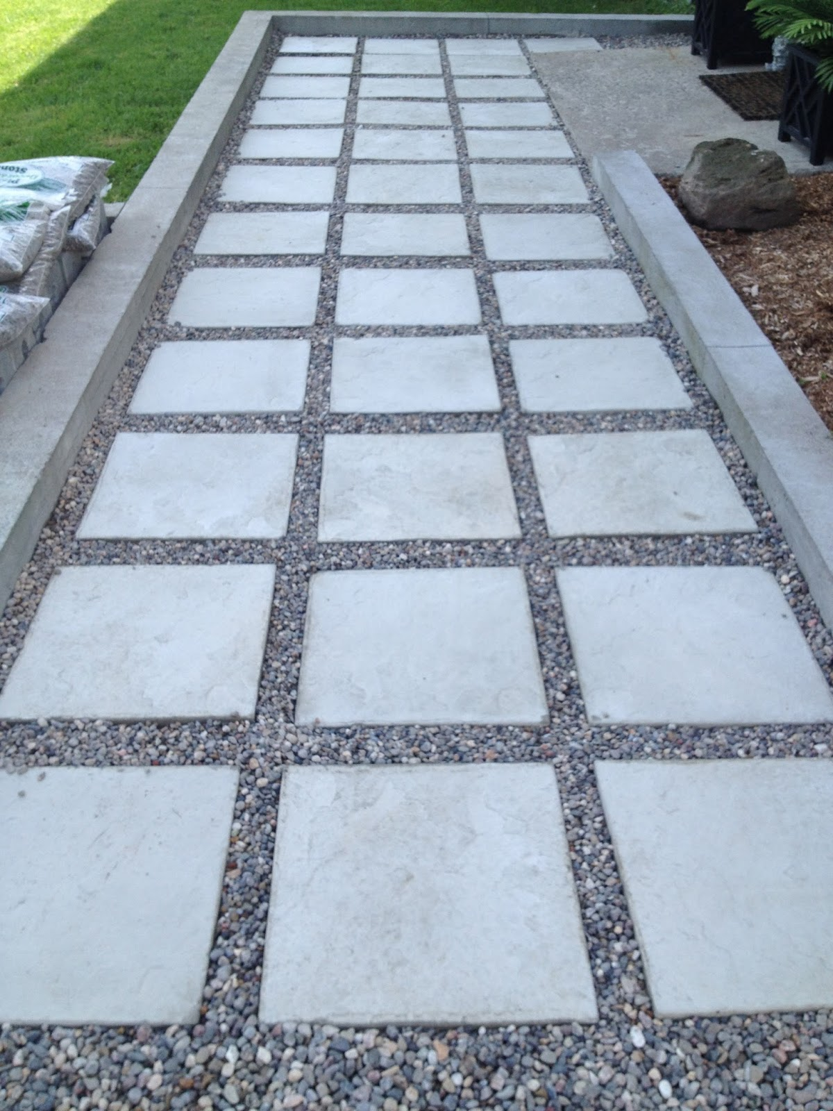 Zen shmen our diy front path makeover for Stone patio ideas on a budget