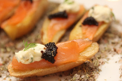 Smoked Salmon, Creme Fraiche, Caviar on Roasted Fingerling Potatoes