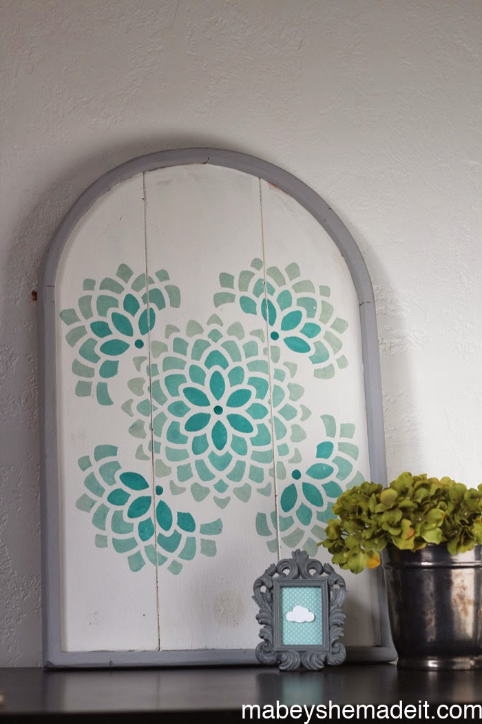 http://www.mabeyshemadeit.com/stenciled-arch-tutorial-with-ombre/