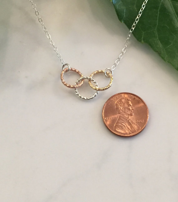 The funky monkey giveaway tri metal tiny circles necklace from the high quality necklace features three interlocking tiny circles of faceted wire made from sterling silver 14k gold fill and 14k rose gold fill aloadofball Image collections