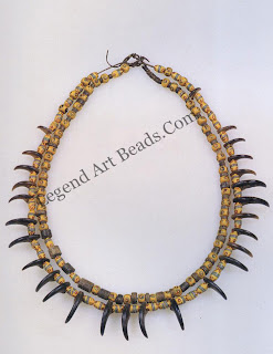 Dakota (Sioux) necklace of Venetian beads, fossil crinoid stems, and bear claws strung on leather thongs, c. 1850. Grizzly bear claws were highly prized and worn only by leaders.