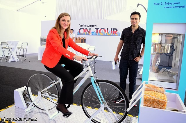 Yet another creative fun station, shown here Ms Petra Schreiber, Director, Marketing & Communication, Volkswagen Malaysia cycling to pop some popcorns