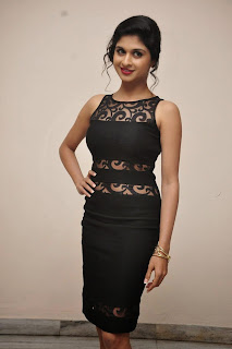 Naveena Pictures in Black Short Dress at Ice Cream 2 Press Meet