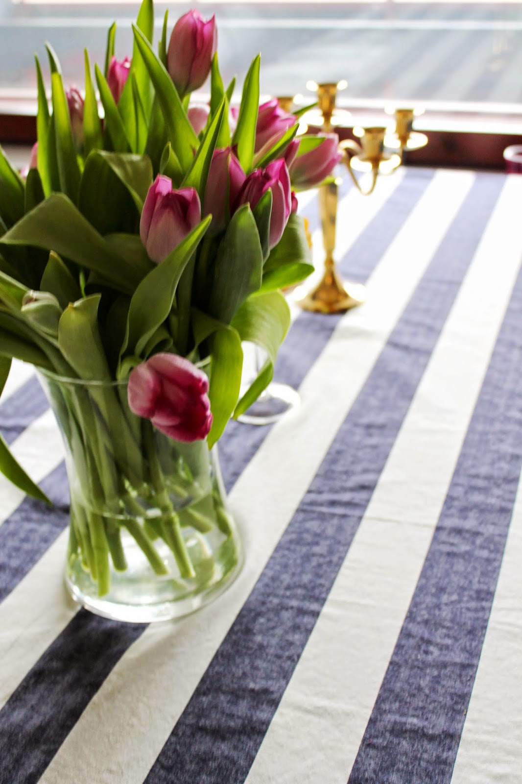 beautiful bright tablescape with tulips and stripes