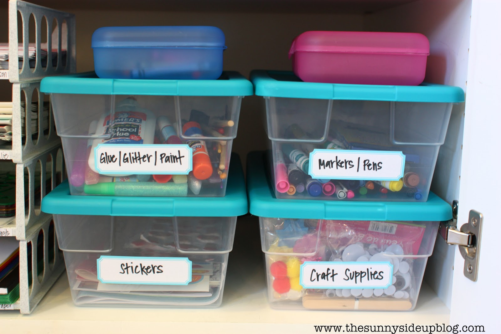 Craft supply storage containers - The Four Clear Containers Hold The Rest Of Our Craft Supplies Glue Glitter Paint Markers Pens Stickers And The Craft Supply Bin Is Full Of Random