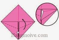 Bước 8: Từ vị trí mũi tên, mở lớp giấy ra, kéo và gấp lớp giấy lên phía trên.