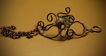 Om symbol wire sculpture bracelet
