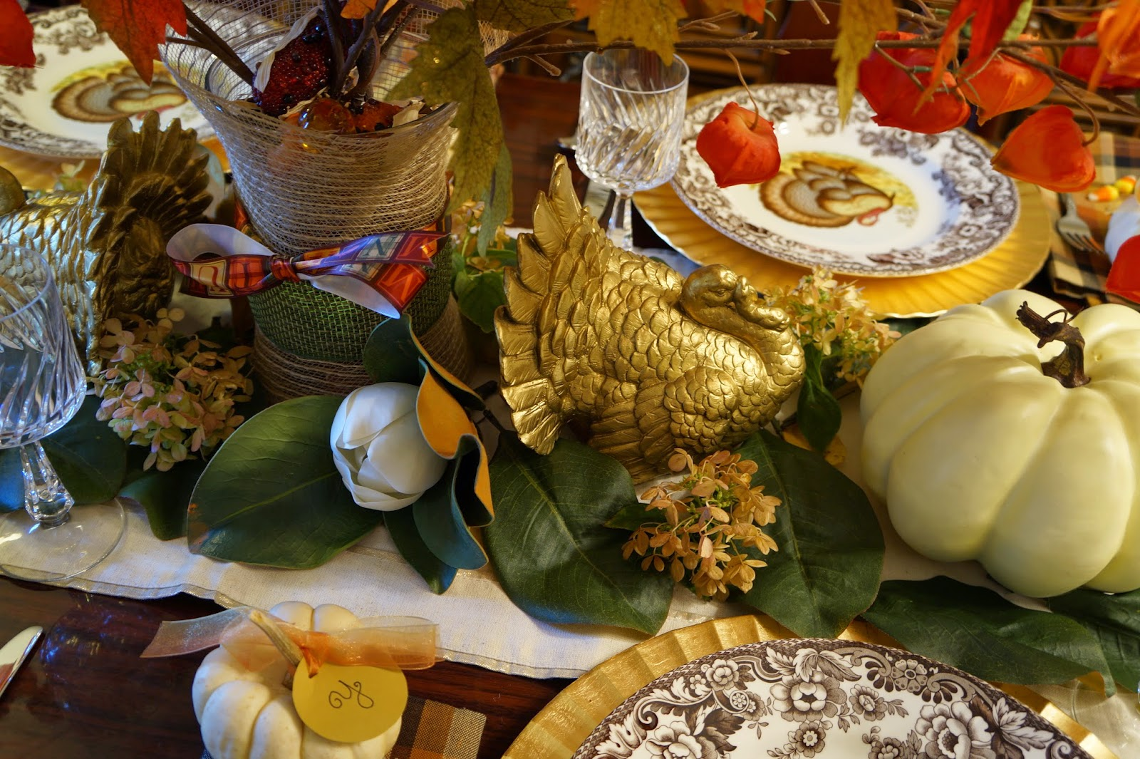 Dine like a king here you can see the base of the centerpiece arrangement which is just a glass vase filled with fall vase filler pumpkins and faux indian corn from pier 1 reviewsmspy