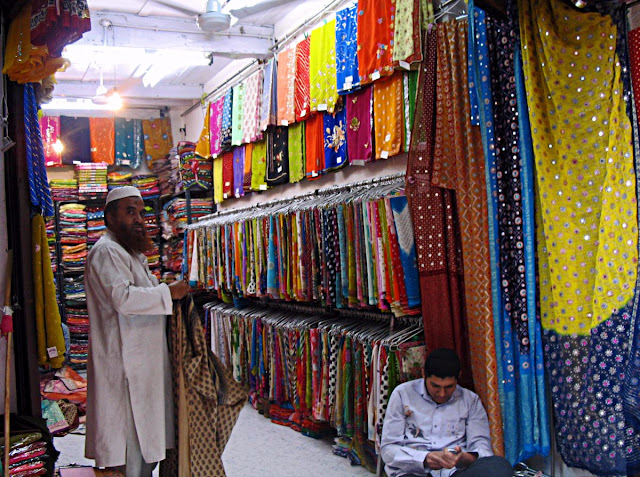 Cloth merchant in shop in market
