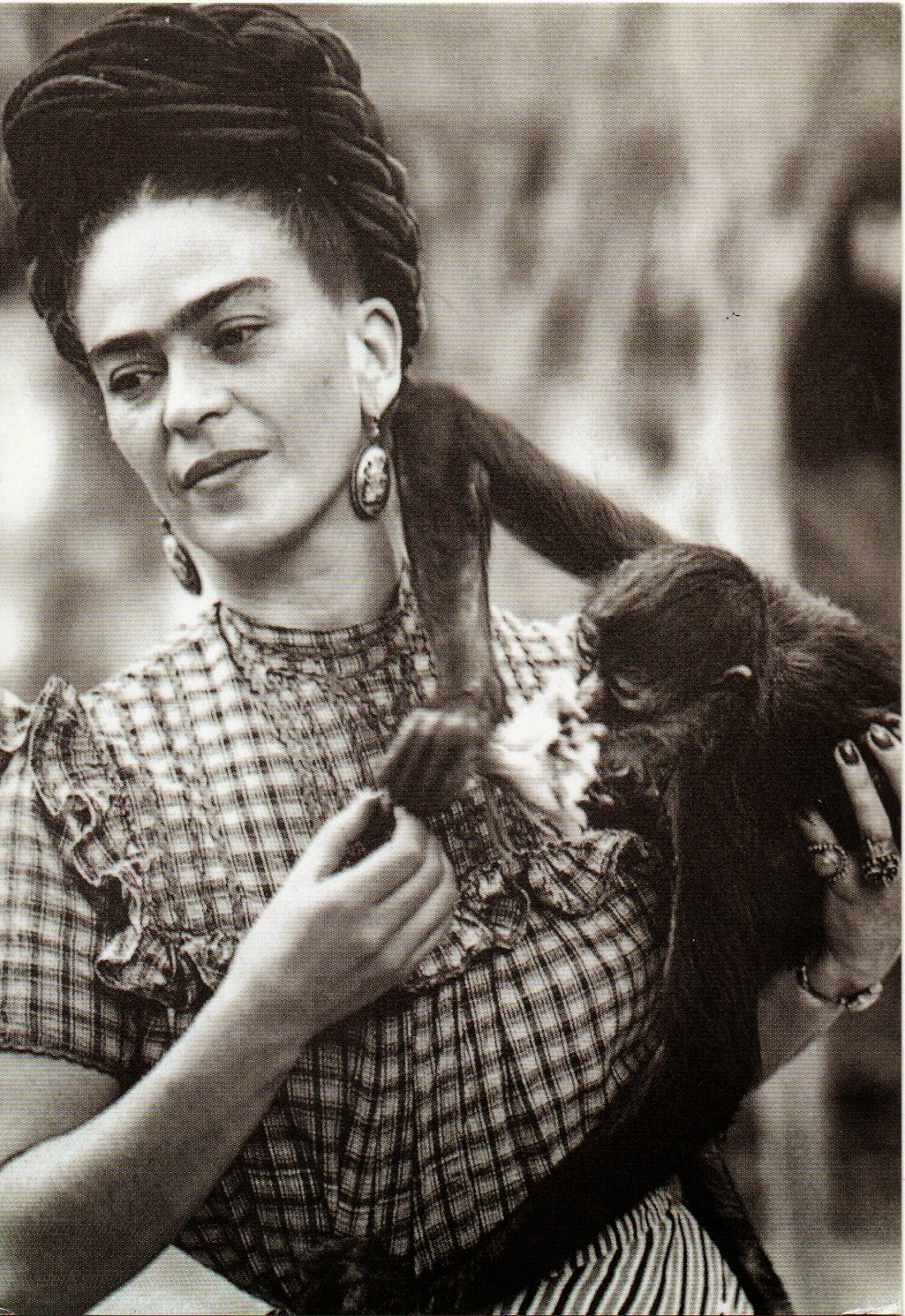 Frida Kahlo holding her pet monkey, Mexico City, 1944.