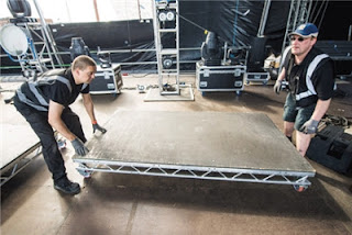 Roadies building a stage