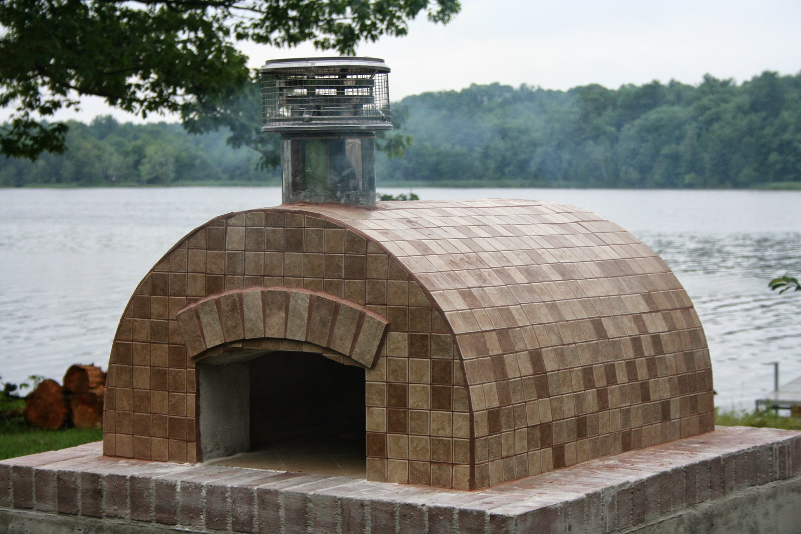 beautiful barrel shaped cortile barile wood fired oven overlooking