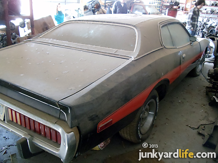 Black 1973 Dodge Charger 440 Magnum Rallye parked for 20 years in storage building at Stinnett's Auto Parts in Alabama on junkyardlife.com
